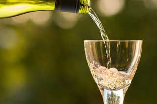 Photo of a glass of cava being poured
